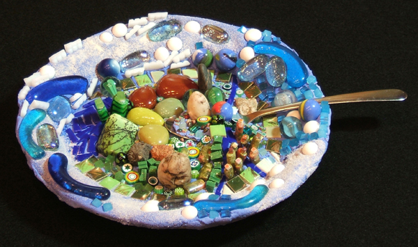 mosaic art about using up the earth's resources by Lynn Bridge