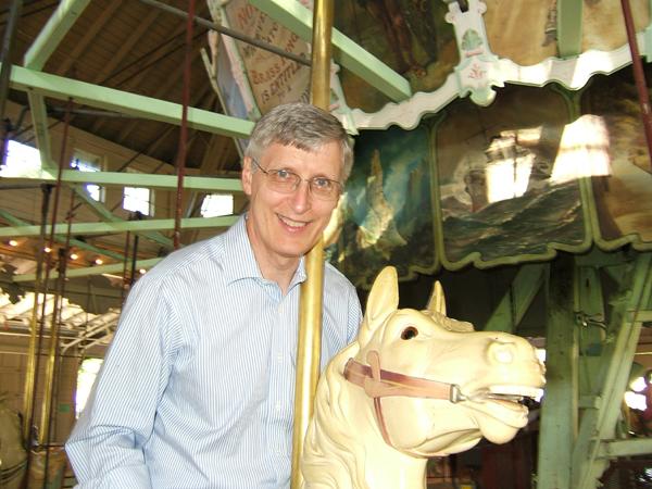 man on antique merry-go-round
