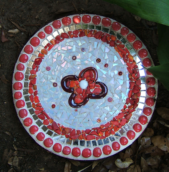 red and white mosaic stepping stone