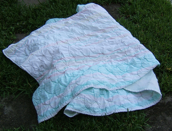blanket wrapped around a piece of safety glass