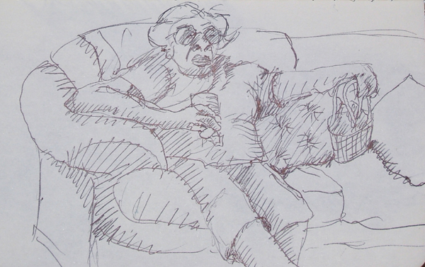 Elderly woman on sofa with soda in hand