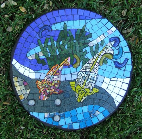 mosaic stepping stone with water and two fish by Lynn Bridge