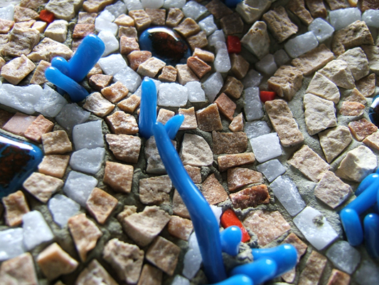 detail of stone and glass mosaic plate by Lynn Bridge