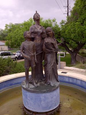 bronze sculpture in front of Carver Museum Austin, TX