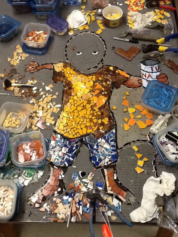 The community-built mosaic I'm supervising is coming along nicely.